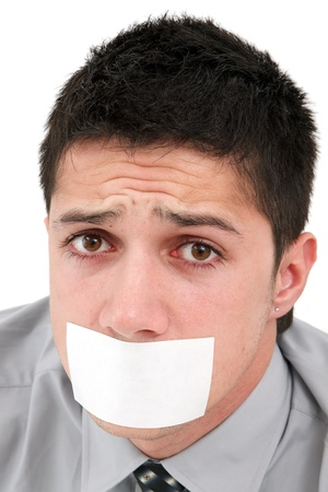 A young businessman with a band on his mouth Stock Photo - 9492826