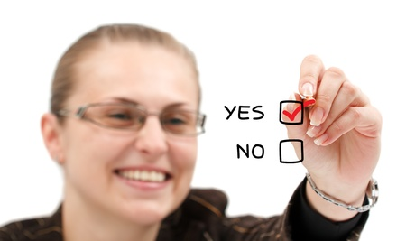 A young attractive businesswoman choosing between Yes or No isolated over a white background Stock Photo - 9493604