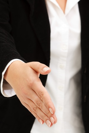 Businesswoman in elegant suit ready to shake hands photo
