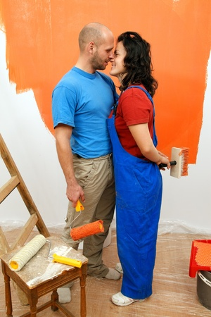 Romantic moments of a young pair during the wall painting Stock Photo - 9490041