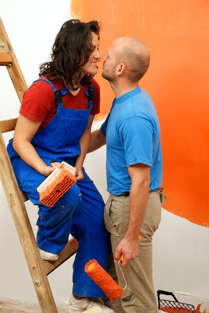 Romantic moments of a young pair during the wall painting  photo