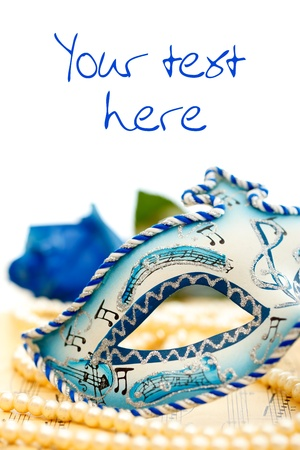 Carnival mask on music paper with place for your text Stock Photo