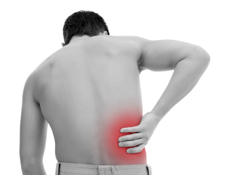 Young man having pain in his back Stock Photo - 9493458