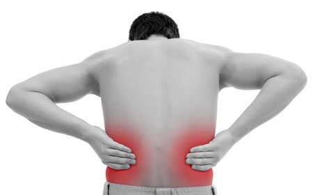 muscle tension tense: Photo of a man with his hands on his back
