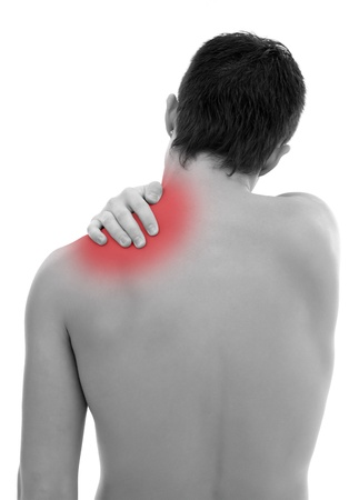 Young man having pain in his shoulder photo