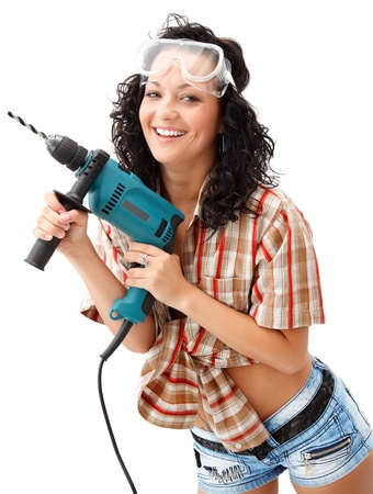 sexy construction worker: A young smiling female worker with a drilling machine