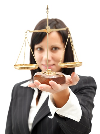 law business: Attractive woman in elegant suit holding scales of balance Stock Photo