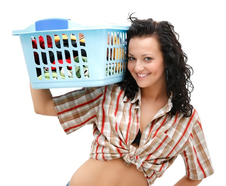 Attractive young woman with the laundry basket on her shoulder photo