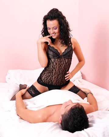 sex couple: Cute passionate couple together on the bed