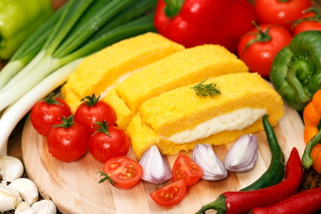 Hominy (mamaliga) with curd cheese and vegetables