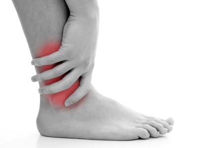 Young man having pain in his ankle Stock Photo - 9493056