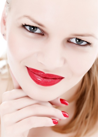 Face of an attractive woman with red lips and nails Stock Photo - 9494000
