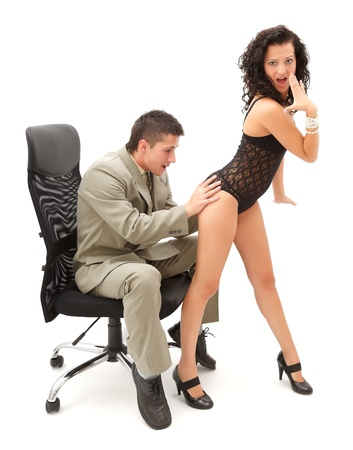 Young businessman touching the ass of a sexy woman