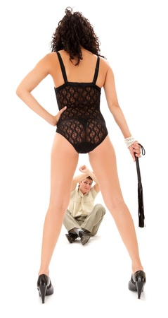 Sexy woman with lash standing before scared businessman Stock Photo - 9546210