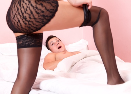 Sexy woman takes her tights off  before her surpised boyfriend