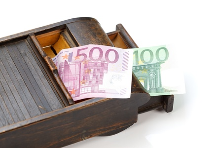 Rustic wooden box with money inside, over white background Stock Photo - 9596162