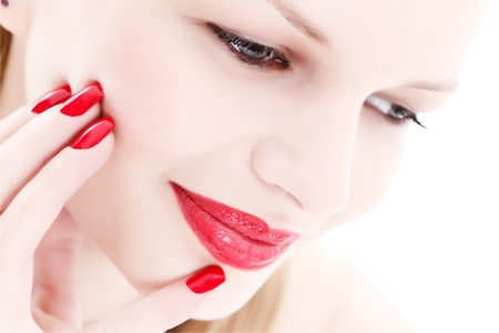 Portrait of a beautiful woman with red lips and nails Stock Photo - 9639755