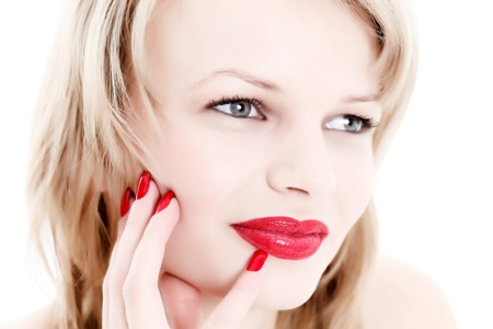 Portrait of an attractive young woman with red nails and lips Stock Photo - 9864115