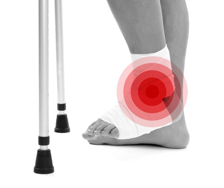 Man with a broken leg and crutches isolated over white background Stock Photo