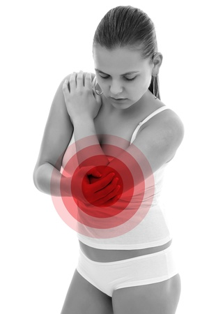 Young woman holding her elbow, having pain photo