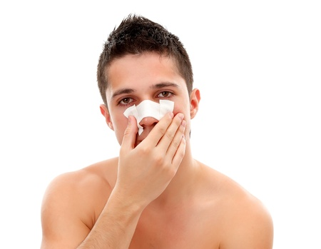 Young man having a nasal bandage, isolated on white background Stock Photo