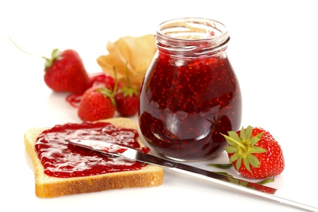 Strawberry jam and toast between fresh fruits photo