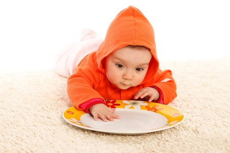 Little girl searching food in the plate photo