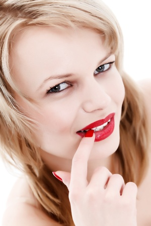 Young mysterious blonde woman with red lips and nails Stock Photo - 10044506