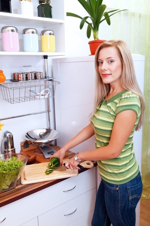 Friendly young woman cooking a meal photo
