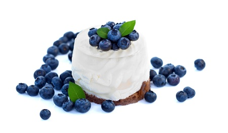 Cheesecake with blueberries on white background