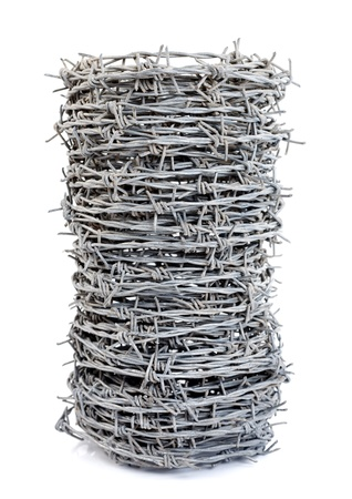 A roll of barbed wire over white background Stock Photo