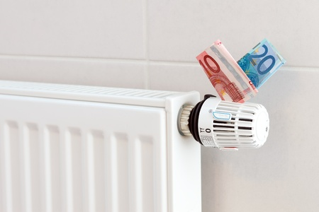 Heating thermostat with euros, expensive heating concept