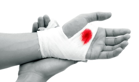 white bandage: Hand of a man with bloody gauze on it