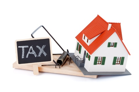 residence: Miniature house in mousetrap of taxes, concept Stock Photo