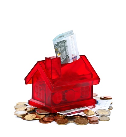 Miniature red house with money, concept Stock Photo - 10997819
