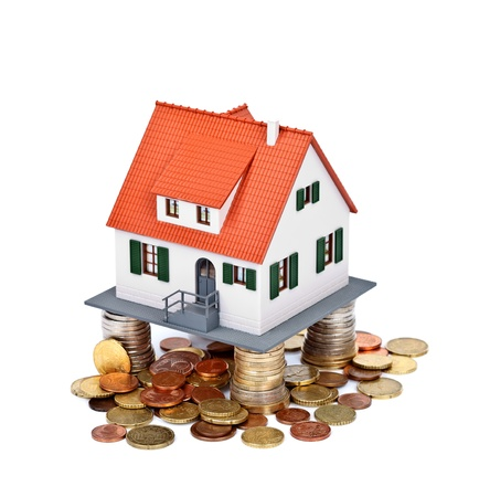 toy house: House on money coins, safe base concept Stock Photo