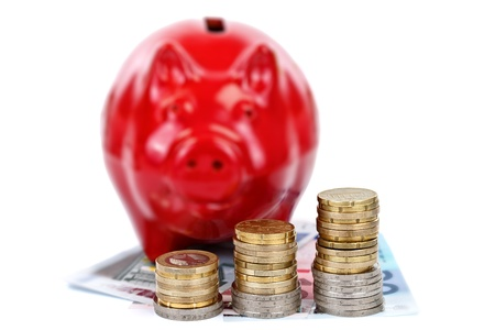 Money coins with a red piggy bank, concept Stock Photo - 10997818