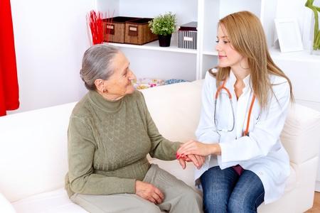 Nurse holding an elderly womans hand