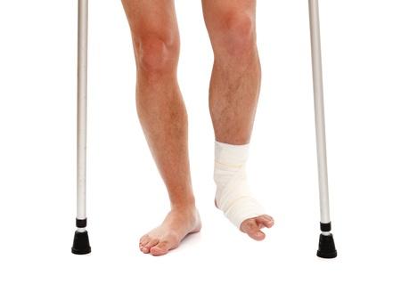Man with walker having white bandage gauze on left leg