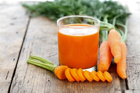 carrot juice: Fresh smoothie with carrots on a wooden table