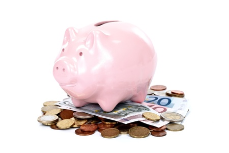 Money with a pink piggy bank, concept Stock Photo - 11321465