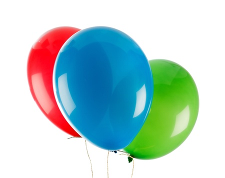 Three colorful party baloons over white background photo