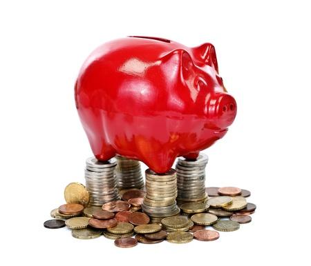 Red piggy bank on money coins, safe base concept Stock Photo - 11321472