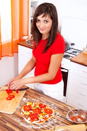 Woman making pizza at home Stock Photo - 11716982