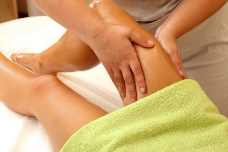Relaxing massage for a woman in a salon