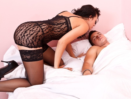 Sexy woman waking up her husband