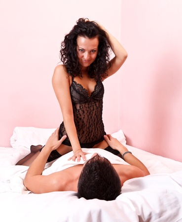 young couple sex: Passionate couple in bed