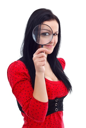 Girl holding magnifying glass in front of her eyes Stock Photo
