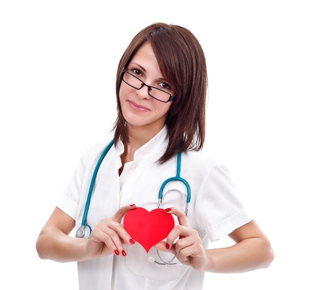 Smiling nurse showing us the place of the heart photo