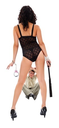 Sexy woman with handcuff and lash standing before scared businessman Stock Photo - 12176178